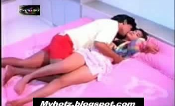 Wife and friend on bed romancing