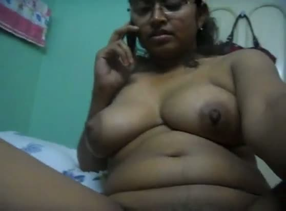 Bbw aunty rubs pussy while speaking on phone
