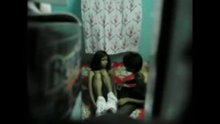 Young couple fooling around at home