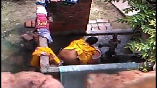 Indian village aunty open bathing video recorded
